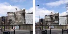 Po bëheshin gati ta demolojnë ndërtesën e vjetër, copa e madhe e betonit këputet dhe fluturon në rrugë – burri i shpëton vdekjes për pak centimetra (Video)