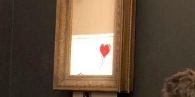 """Gjatë """"vetë-shkatërrimit"""" të pikturës nga Banksy, në sallë dyshohet se ishte edhe artisti misterioz (Video)"""