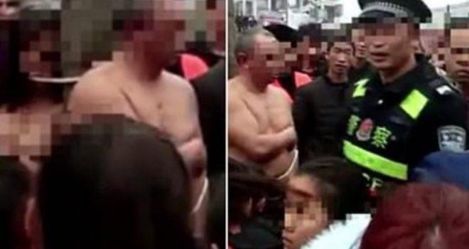 E zë burrin me tjetrën, kinezja e nervozuar zhvesh dyshen dhe i lidh në pemë në mes të qytetit (Video)